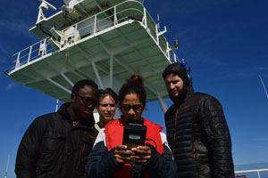 ESSIC's Santiago Gassó (second from left) teaches graduate students how to make atmospheric measurements on board the German research icebreaker Polarstern. Image credit: X. Vega (UMAG) (Click image to download hi-res version.)