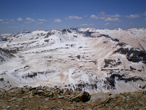 This 2009 photograph shows the deposition of large quantities of dust from the deserts of the Colorado Plateau onto snowpack in the Colorado Rockies. A new University of Maryland-led study suggests that dust from Middle Eastern deserts settles on the Tibetan Plateau and Himalaya mountain range, accelerating snow melt and strengthening the summer monsoon season in India. Image credit: S. McKenzie Skiles, Snow Optics Laboratory, NASA/JPL (Click image to download hi-res version.)