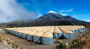 The HAWC Observatory, perched next to a volcano at an altitude of 13,500 feet, uses its 300 massive water tanks to scoop up the products of high-energy particle collisions happening in the upper atmosphere. Image credit: Jordan Goodman (Click image to download hi-res version.)