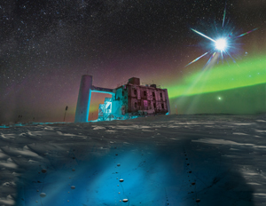 In this artistic rendering, based on a real image of the IceCube Lab at the South Pole, a distant source emits neutrinos that are detected below the ice by IceCube sensors. Image credit: IceCube/NSF (Click image to download hi-res version.)