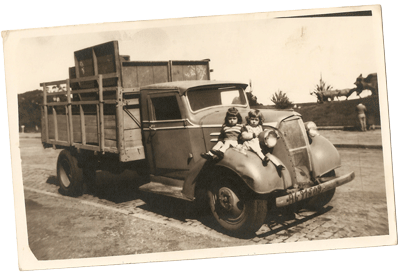 Patrizia Barone (right) with her sister, Sapienza Barone, B.A. '77, English, and the infamous truck.